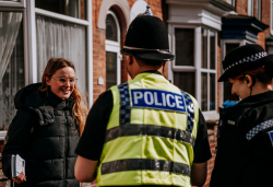 Police Officers talking to lady on pavement