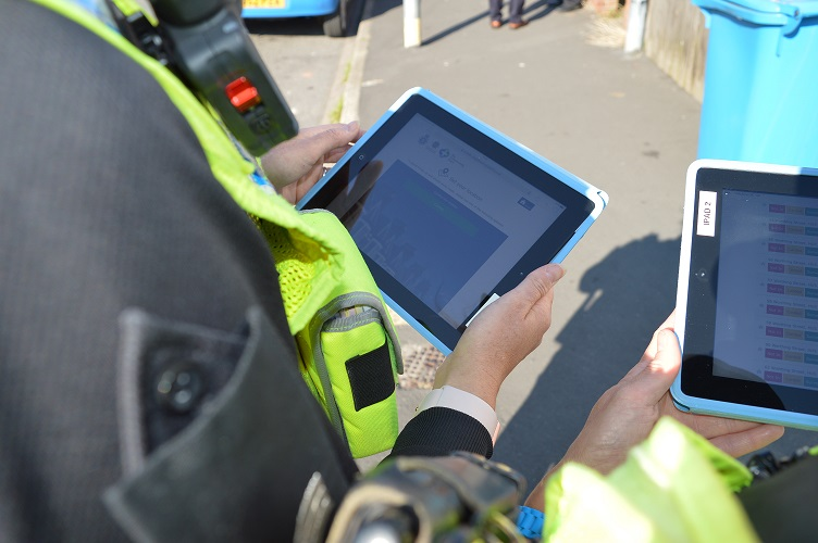 Officer viewing information on tablet screen